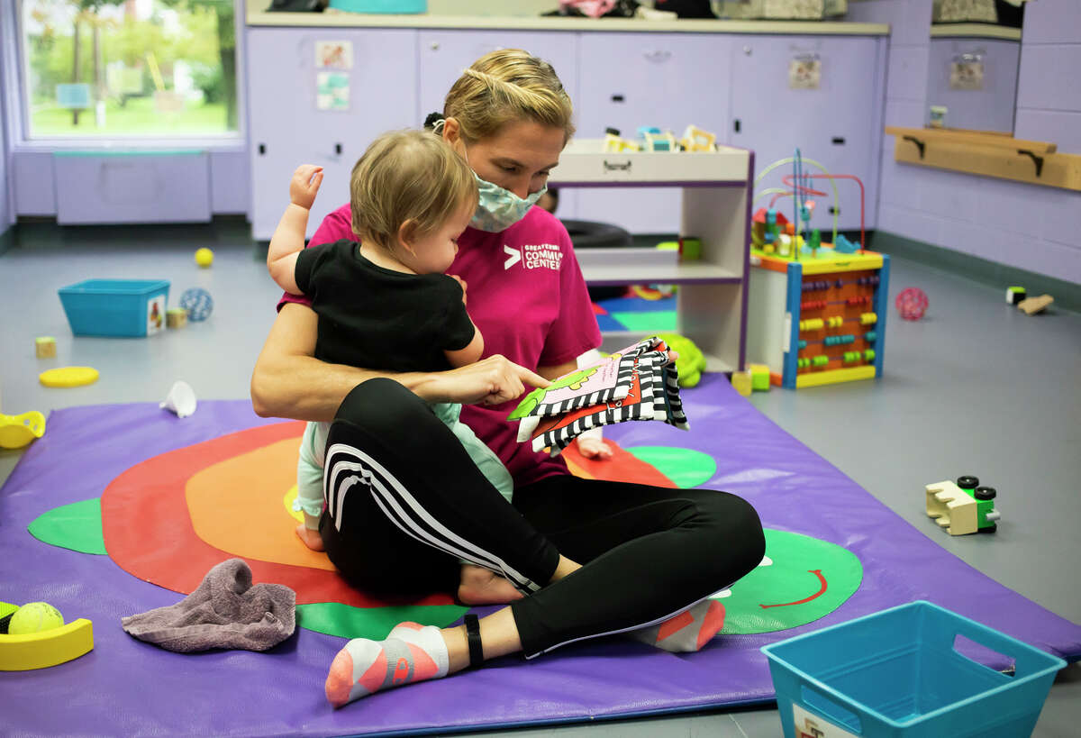 Jeanenne Heye comforts a baby Thursday, Sept. 23, 2021 at the Greater Midland Community Center's early childhood center in Midland. (Katy Kildee/kkildee@mdn.net)