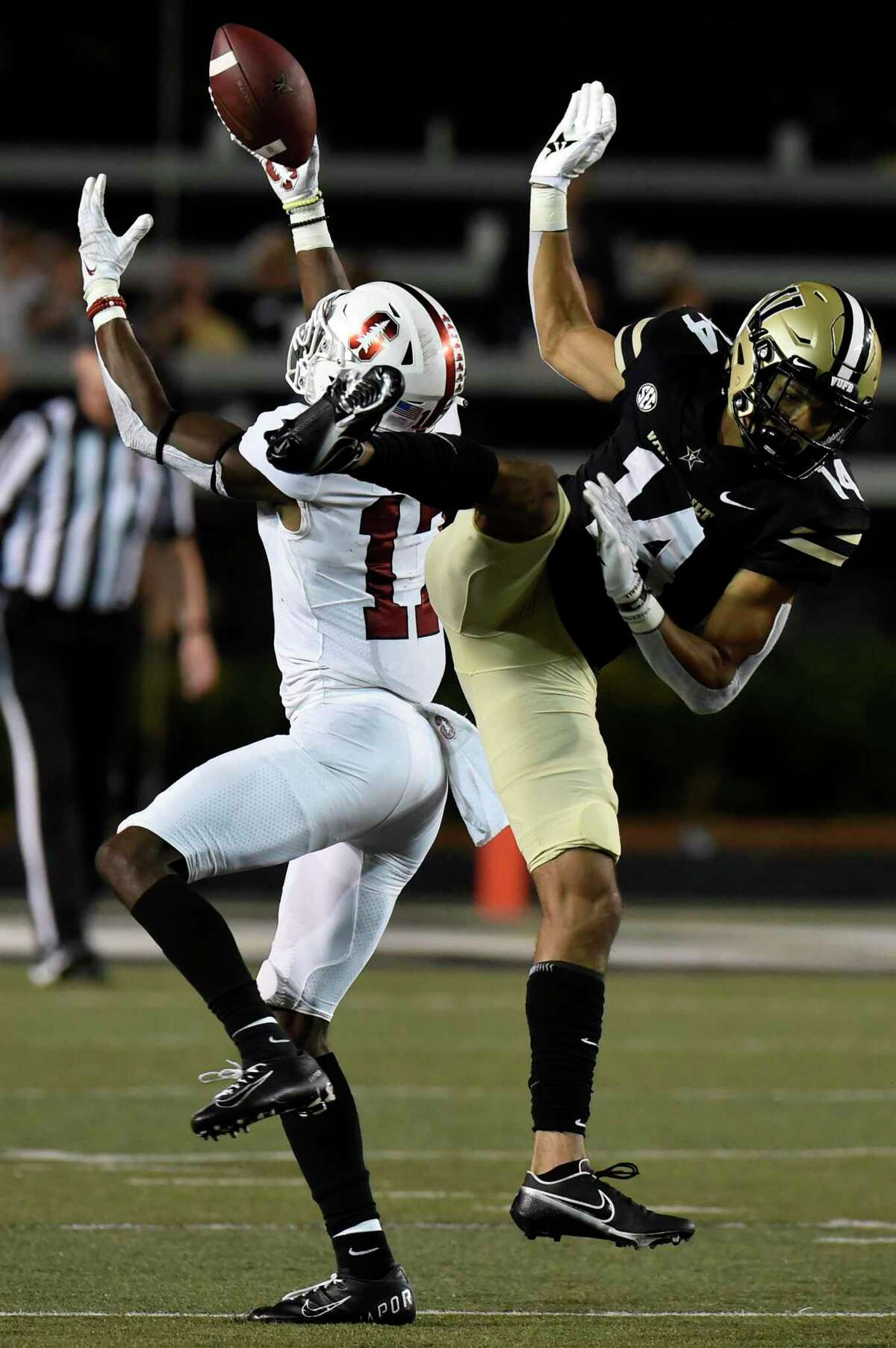 Stanford cornerback Kyu Blu Kelly (17) breaks up a pass intended for Vanderbilt wide receiver Will Sheppard (14) in the second half of an NCAA college football game Saturday, Sept. 18, 2021, in Nashville, Tenn. (AP Photo/Mark Zaleski)