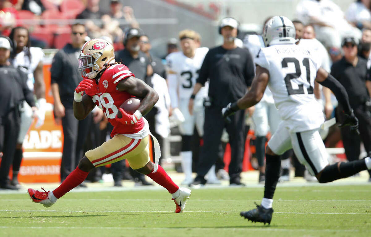 Trey Sermon of the San Francisco 49ers rushes during the game against the Las Vegas Raiders at Levi's Stadium on August 29, 2021 in Santa Clara, California. The 49ers defeated the Raiders 34-10.