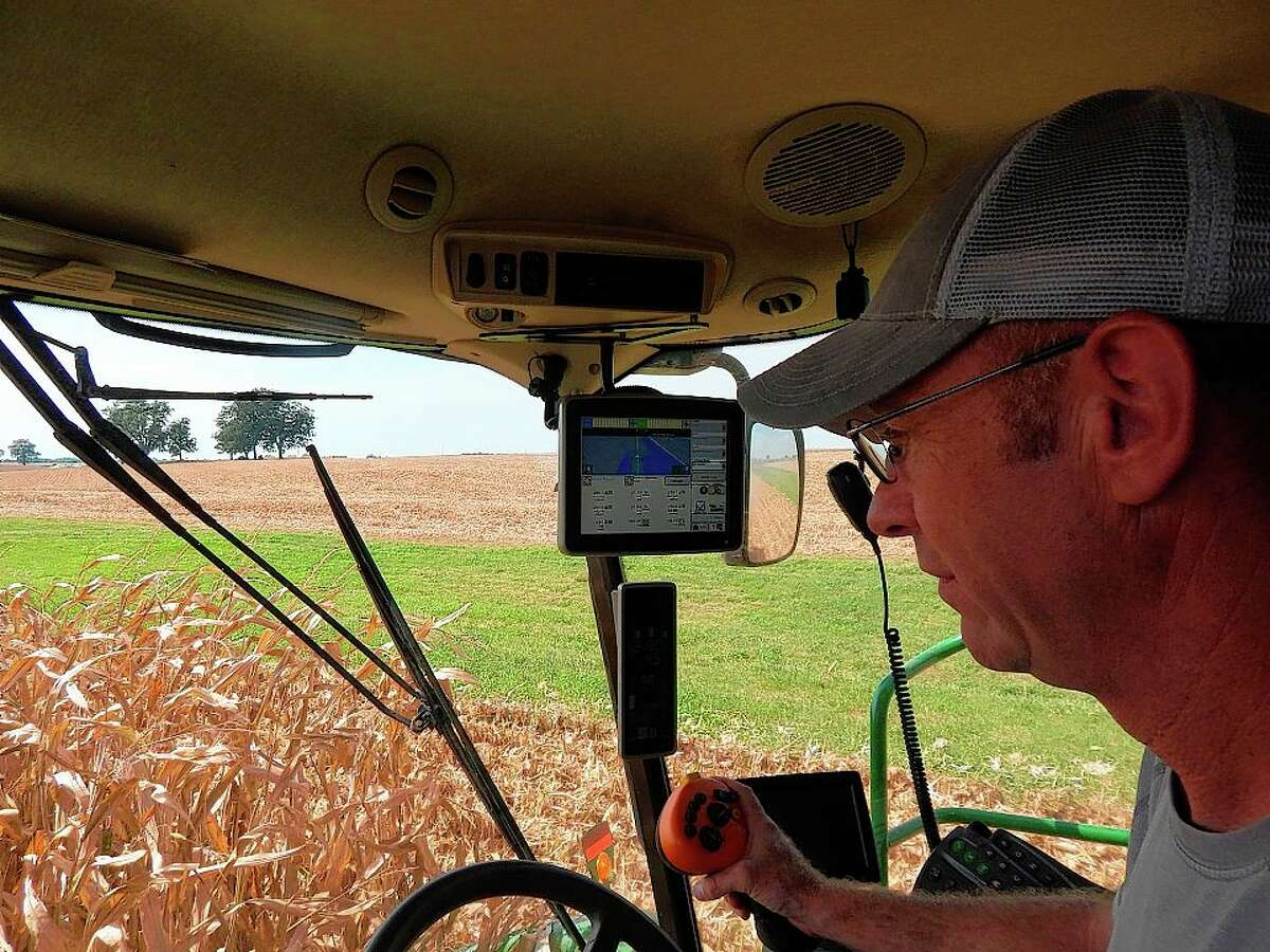 Doug Coop operates a combine while harvesting his corn crop on the Liberty Road land he farms with his father, Ric. When not tending to his farm, Coop is actively involved with Cass-Morgan Farm Bureau and encouraging other farmers to think about an emergency preparedness plan for their farms.
