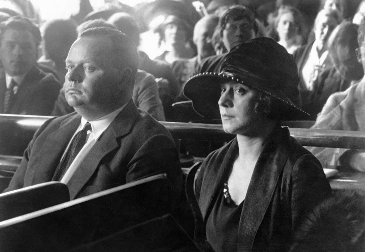 """Roscoe """"Fatty"""" Arbuckle and his wife, Rosene, seated together in court."""