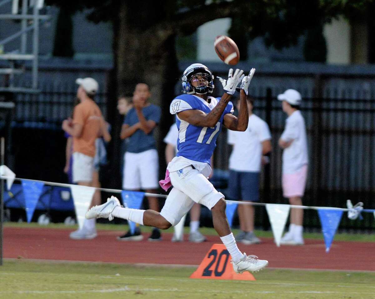 Jaylen Waddle (17) of Episcopal hauls in a pass from quarterback Gavin Geib (15) and carries it for his second touchdown during the first quarter of a high school football game between the Episcopal Knights and Kinkaid Falcons on September 30, 2016 at Episcopal Stadium, Houston, TX.