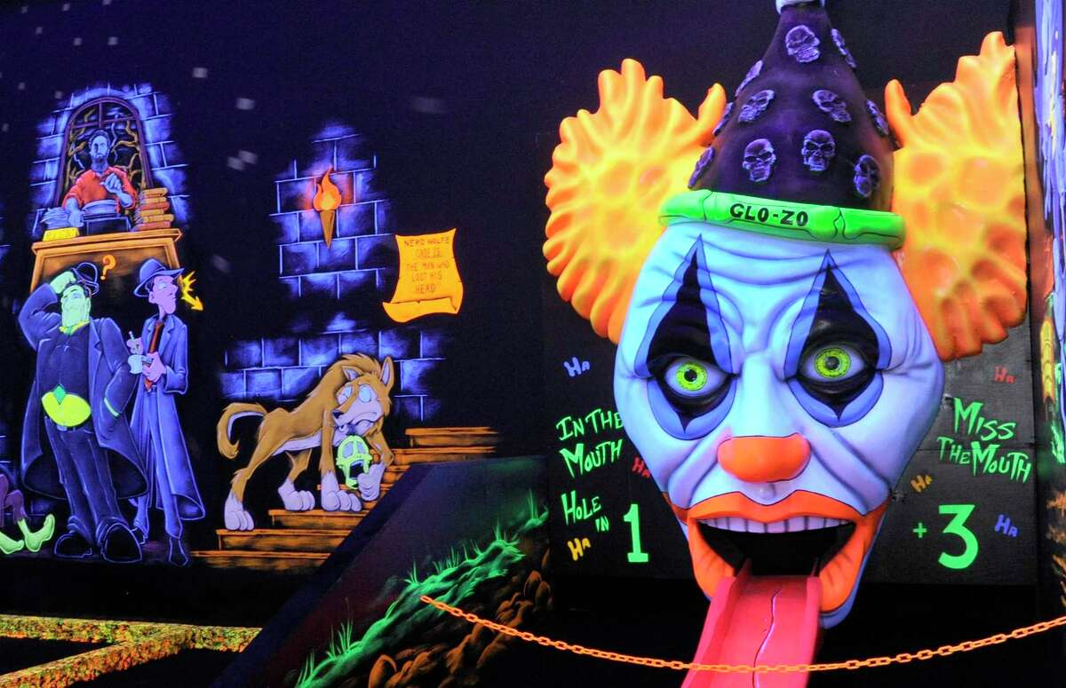 Golfers must confront Glo-Zo the clown before completing a round at Monster Mini Golf .