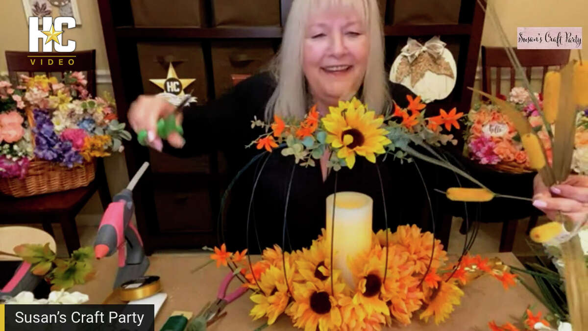 Susan Barber trims flowers while making a pumpkin centerpiece during a Facebook Live session of Susan's Craft Party, Sept. 22, 2021.