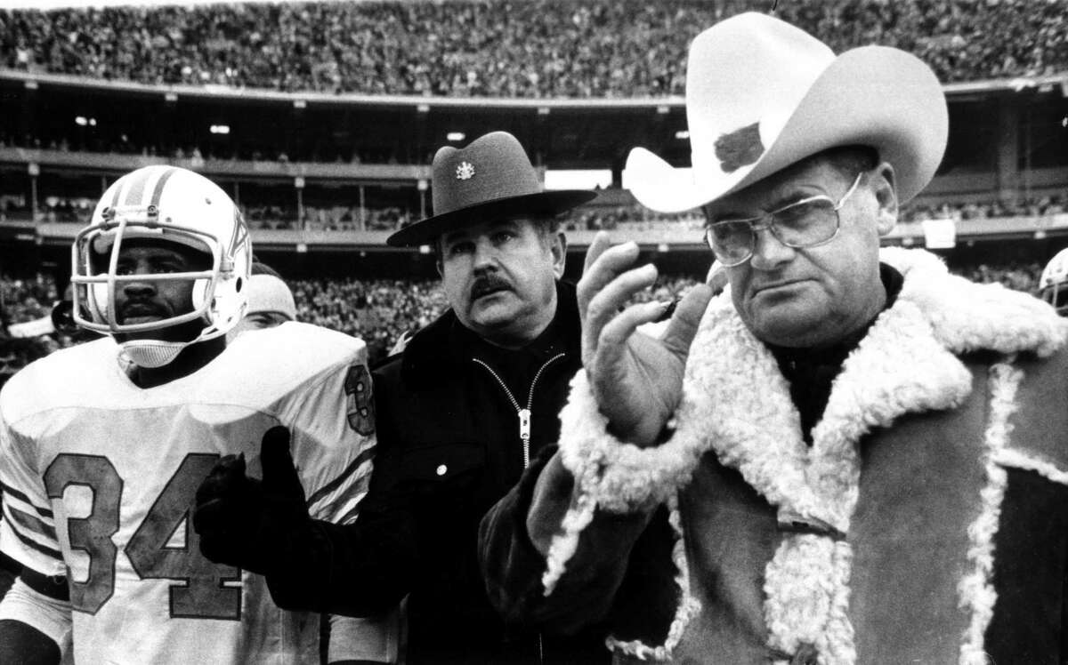 Houston Oilers coach Bum Phillips and running back Earl Campbell leave the field after a second consecutive loss to Pittsburgh in the AFC title game.