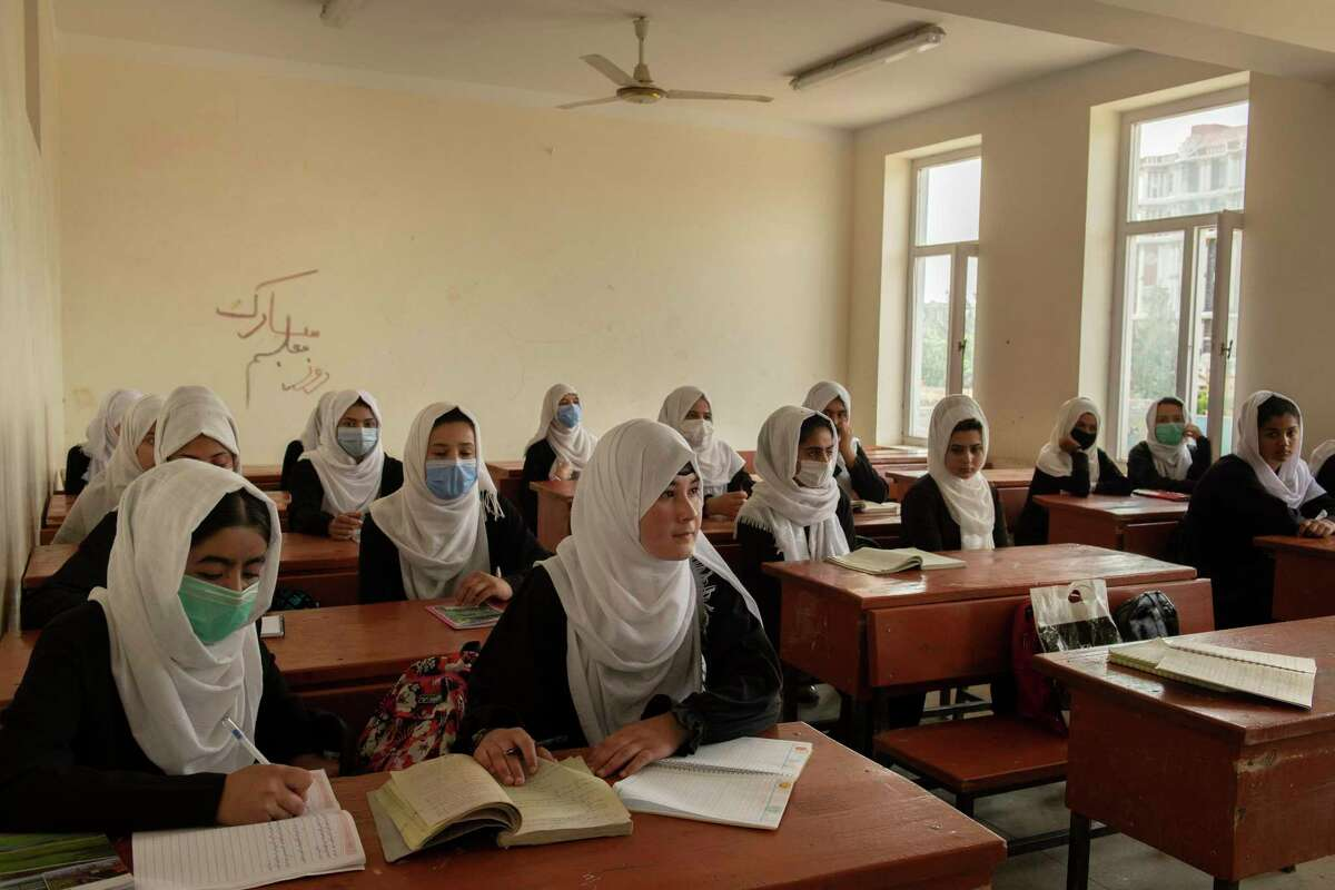 A reader compares Texas restrictions on women's rights to the Taliban. In Texas, women cannot get abortions after six weeks. In Afghanistan, girls can no longer attend school as seen here in May before the Taliban takeover.