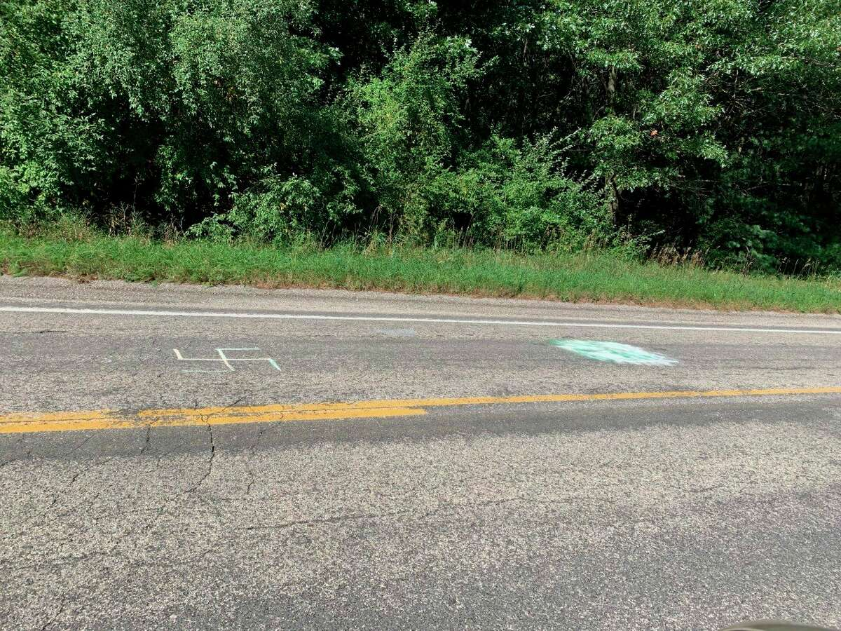 A swastika appears next to another one that was covered up near Red Apple Road. (Courtesy Photo)