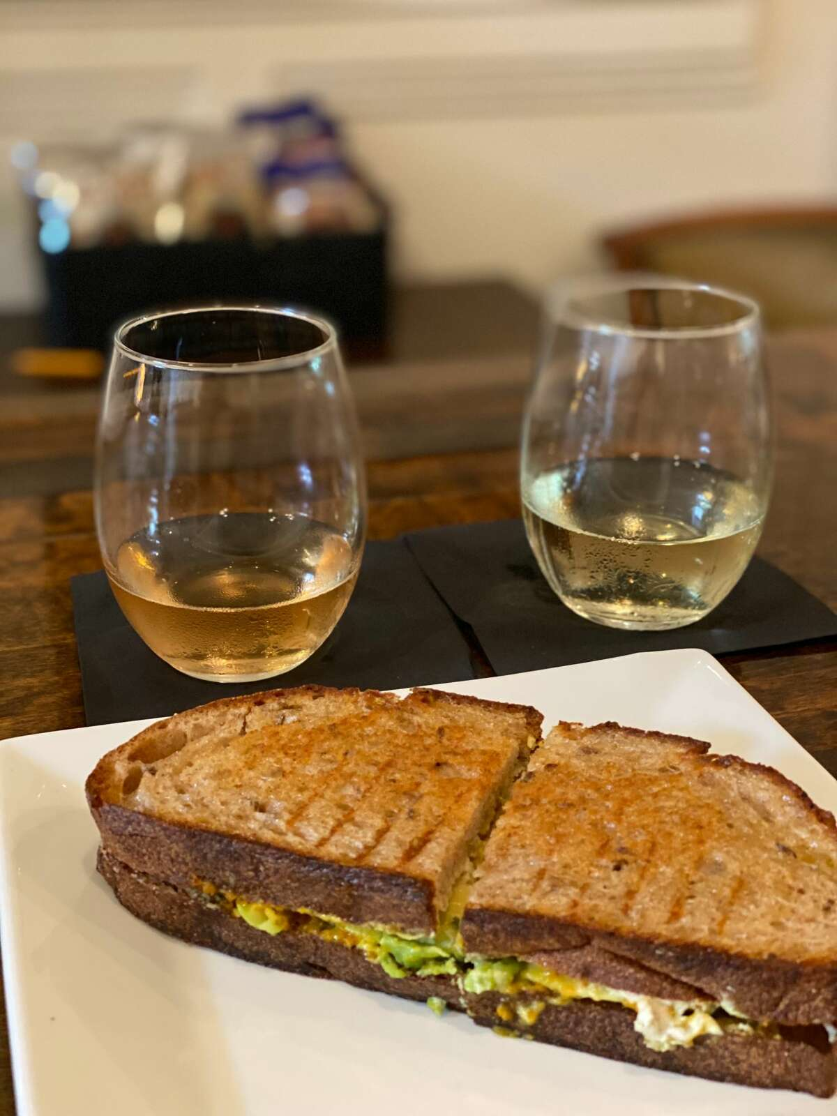 The grilled cashew-cheese sandwich on local rye at Poured Candle Bar in Hudson has avocado and ginger-turmeric jam.