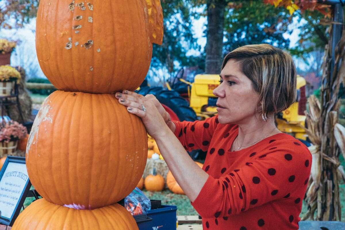 "Chrissy Scarpati of Monroe carves her pumpkins, as seen on Food Network's ""Outrageous Pumpkins,"" season 2."