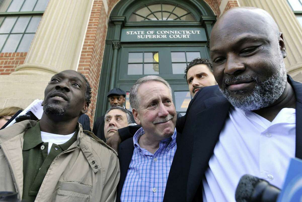 Ronald Taylor, left, Gerald O'Donnell, center, and George Gould, right, speak to the media after a hearing at Rockville Superior Court in Vernon, Conn., Thursday, April 1, 2010.
