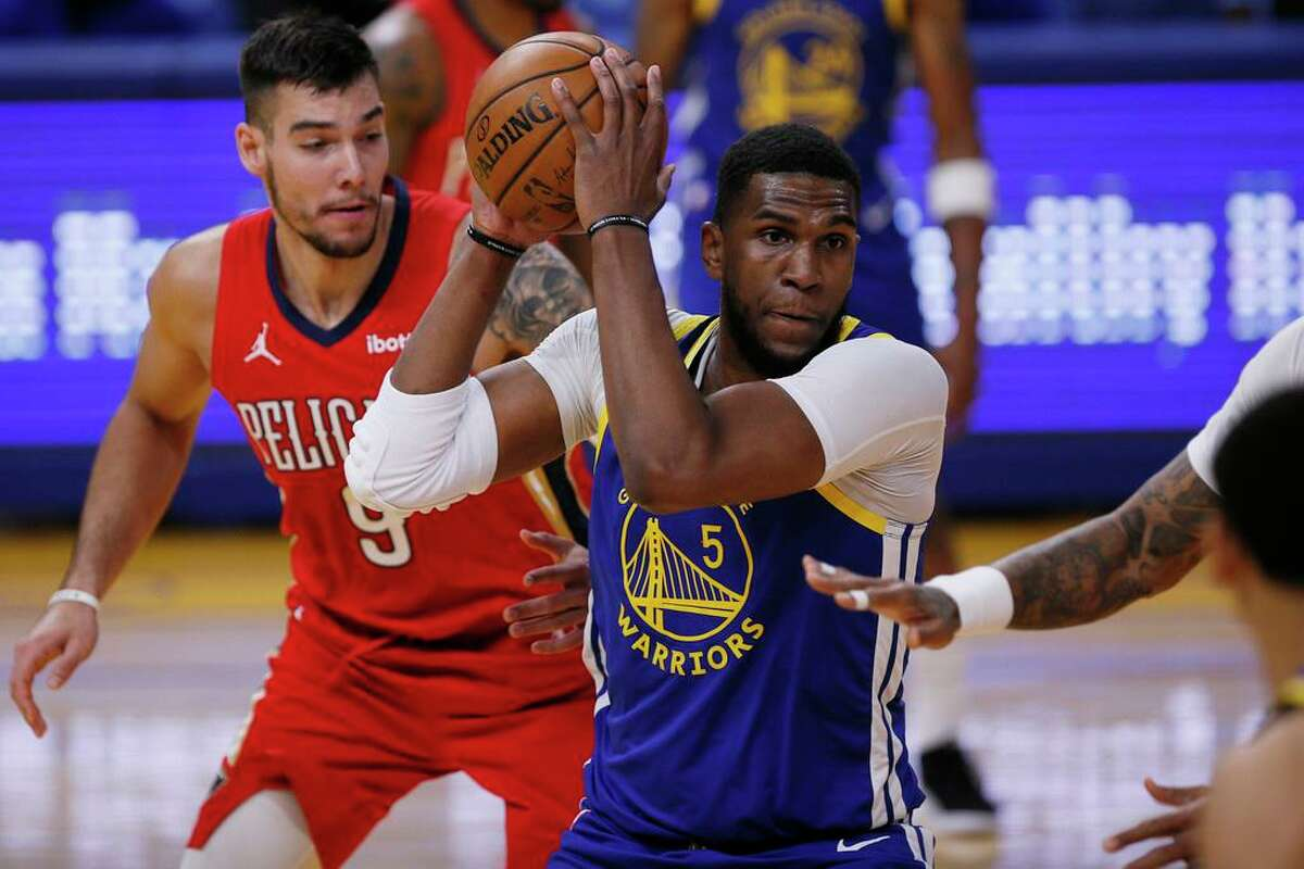 Kevon Looney says his experience could help younger players adjust to expectations that come with being on the Warriors.