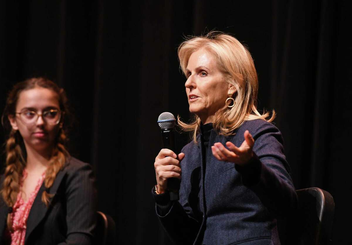 """Venture capitalist Annie Lamont speaks in March 2020 at Greenwich HIgh School in Greenwich, Conn. The new Tidal River angel investment network chaired by Lamont has members backing Owl's Brew, a """"hard sparkling tea"""" startup that has established its headquarters in Stamford."""