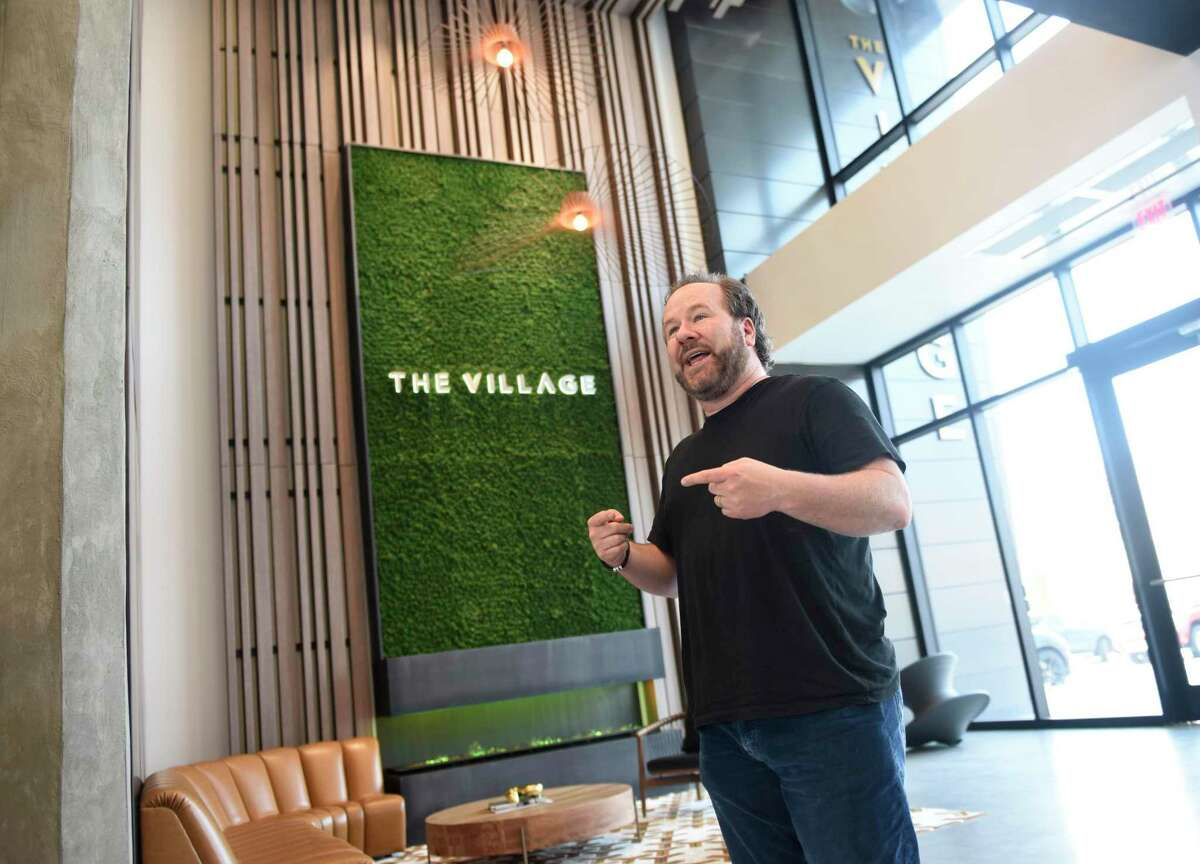 Wheelhouse CEO Brent Montgomery leads a tour in May 2021 of The Village office campus in Stamford, Conn., where Cisco Brewers runs a seasonal beer garden. Owl's Brew is leasing space at The Village as its initial Connecticut headquarters, with the startup making hard sparkling tea in competition with Cisco Brewers and other big labels.
