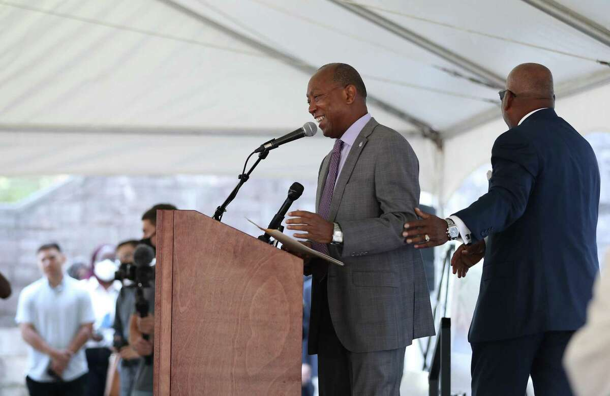 Mayor Sylvester Turner laughs with Fifth Ward CRC, founder and board chair emeritus Reverend Harvey Clemons during a groundbreaking at the old St. Elizabeth Hospital in the Fifth Ward, which is being converted into mixed-income housing, Friday, September 24, 2021, in Houston. The project has attracted some controversy among neighbors, some of whom have decried it as gentrification.