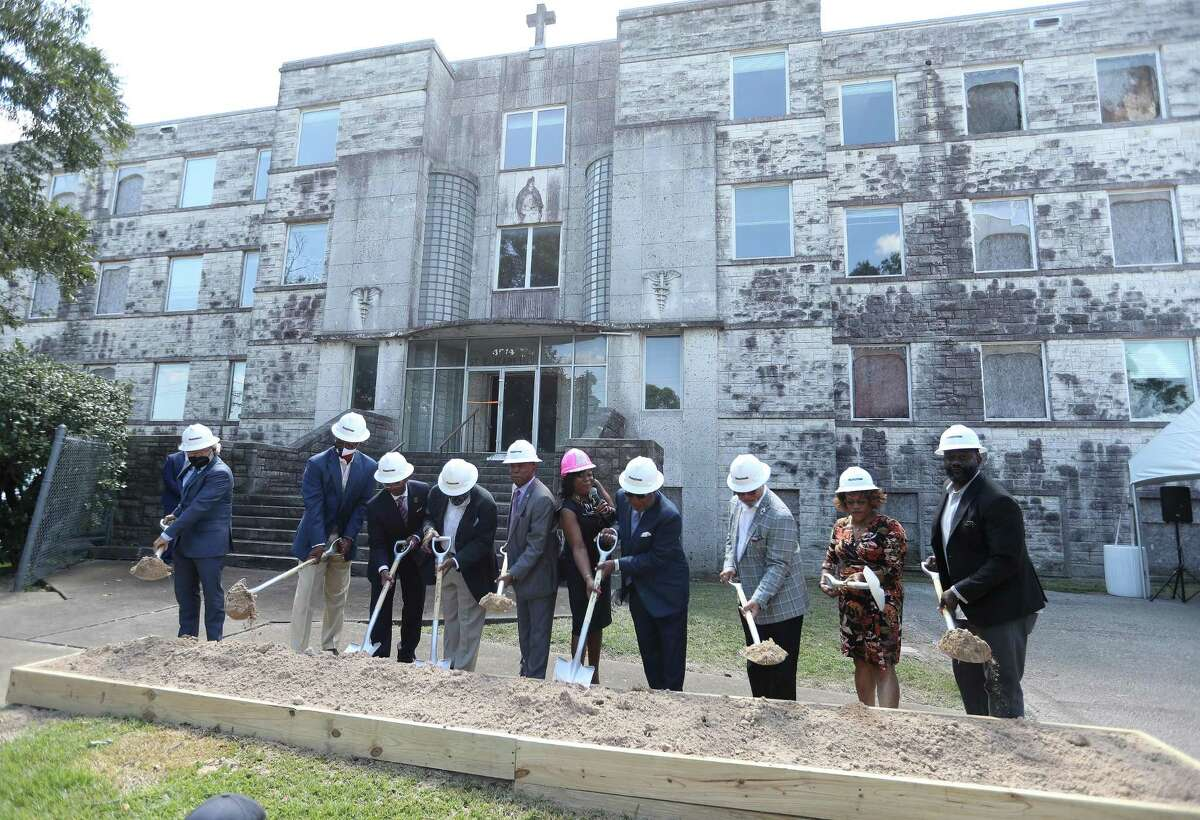 Mayor Sylvester Turner along with Fifth Ward CRC President and CEO, Kathy Flanagan Payton (pink hardhat) and founder and board chair emeritus Reverend Harvey Clemons and others broke ground at the old St. Elizabeth Hospital in the Fifth Ward, which is being converted into mixed-income housing, Friday, September 24, 2021, in Houston. The project has attracted some controversy among neighbors, some of whom have decried it as gentrification.