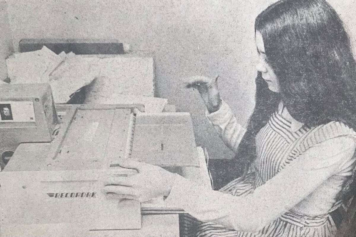 Candy Striper Debbie Sundeck works in the microfilming department at Midland Hospital. March 1974