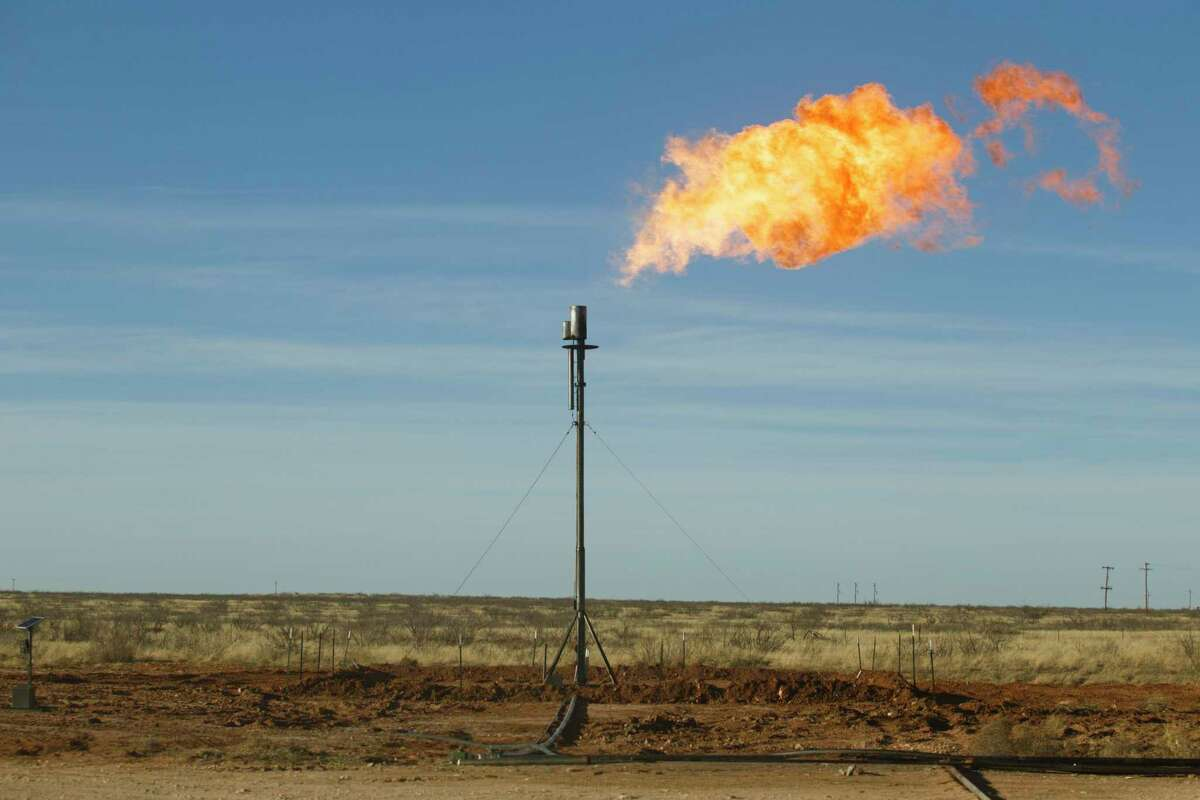 Natural gas is flared at a well site near Odessa. A proposed fee on methane emissions would ripple across the Texas economy.