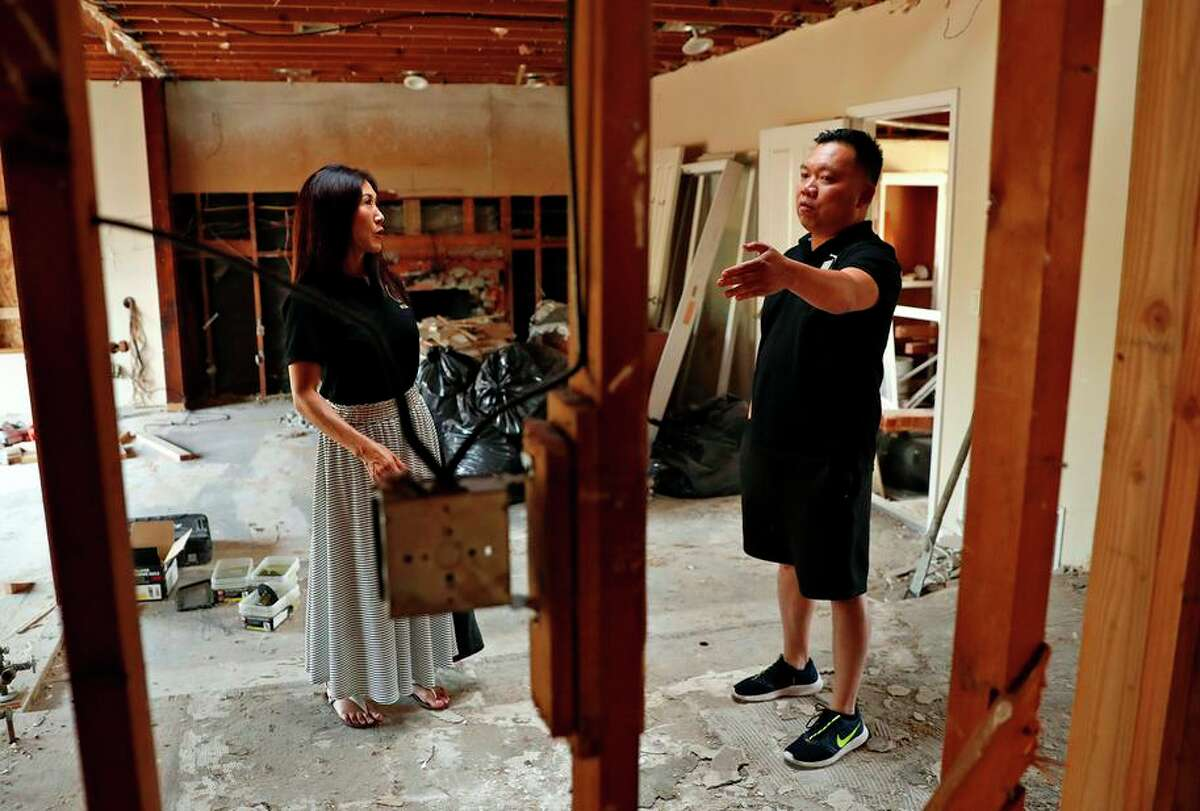 Bay Area Realtor Trinh Wong and business partner Dan Dang check on a San Jose project. The pair also buys Texas homes.