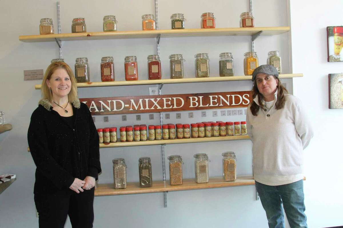 """Deanna Marsh, left, is co-owner and sales and marketing manager for the Northern Spice Company and Dorrett """"Doe"""" Kata is co-owner and spiceologist. Kata said that Northern Spice Company doesn't have any vaccine policy, because they don't want to offend anyone and lose business. (File photo)"""