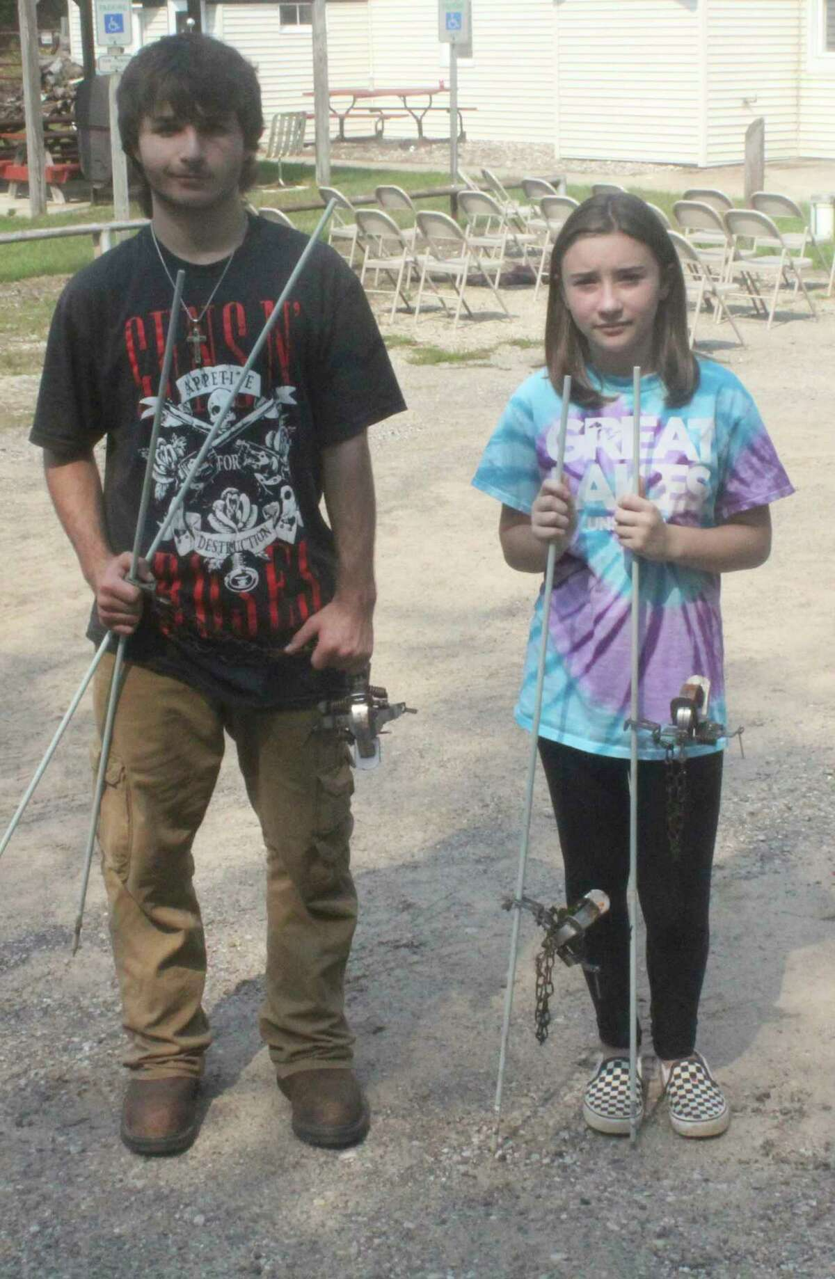 Austin Mata (left), of Barryton, and Andrea Whalen of Sparta attended the trapper's clinic earlier this month at the Mecosta County Rod & Gun Club. (Pioneer photo/John Raffel)