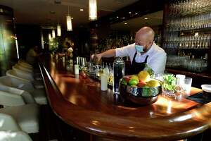 Mixologist Brandon Wagner makea a Perfect Timing at Siena Ristorante at Hotel Zero Degrees Friday, September 24, 2021, in Norwalk, Conn.