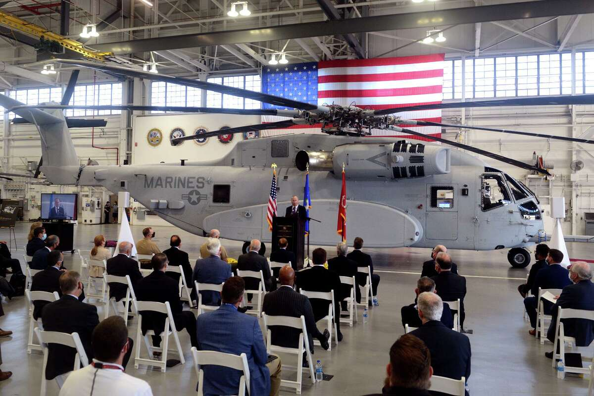 Sikorsky Aircraft President Paul Lemmo speaks during a ceremony next to the first Connecticut built Sikorsky CH-54K King Stallion helicopter held in a hangar at Sikorsky headquarters in Stratford, Conn. Sept. 24, 2021. The new generation of the CH-53's are being built in Stratford for the U.S. Marines.