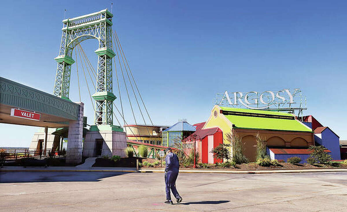 A customer walks toward the entrance of the Argosy Casino Alton on Thursday. The casino this month is marking its 30th anniversary and its role in history as the first modern gambling riverboat in Illinois. - John Badman The Telegraph