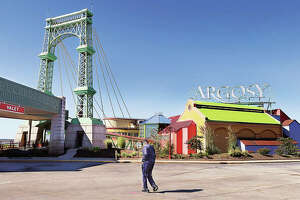 A customer walks toward the entrance of the Argosy Casino Alton on Thursday. The casino this month is marking its 30th anniversary and its role in history as the first modern gambling riverboat in Illinois.