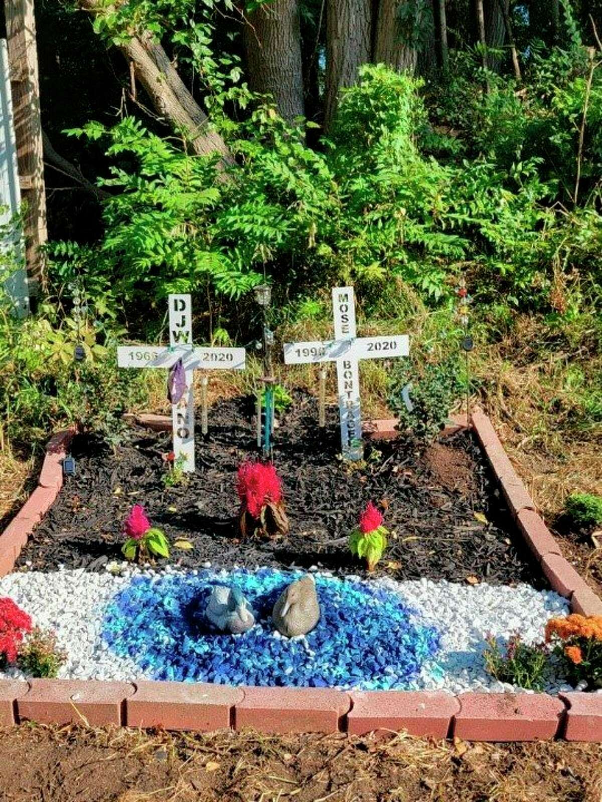 Memorial flowers planted for Dan and Mose by their families. (Courtesy photo)