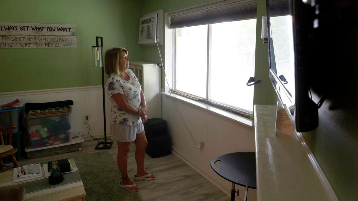 Rose Scheer stands in her Danbury, Conn, apartment. The Connecticut Department of Labor claimed Scheer was paid more unemployment benefits than she was entitled to and wanted the money back. Scheer is moving to Florida. Friday, September 24, 2021.