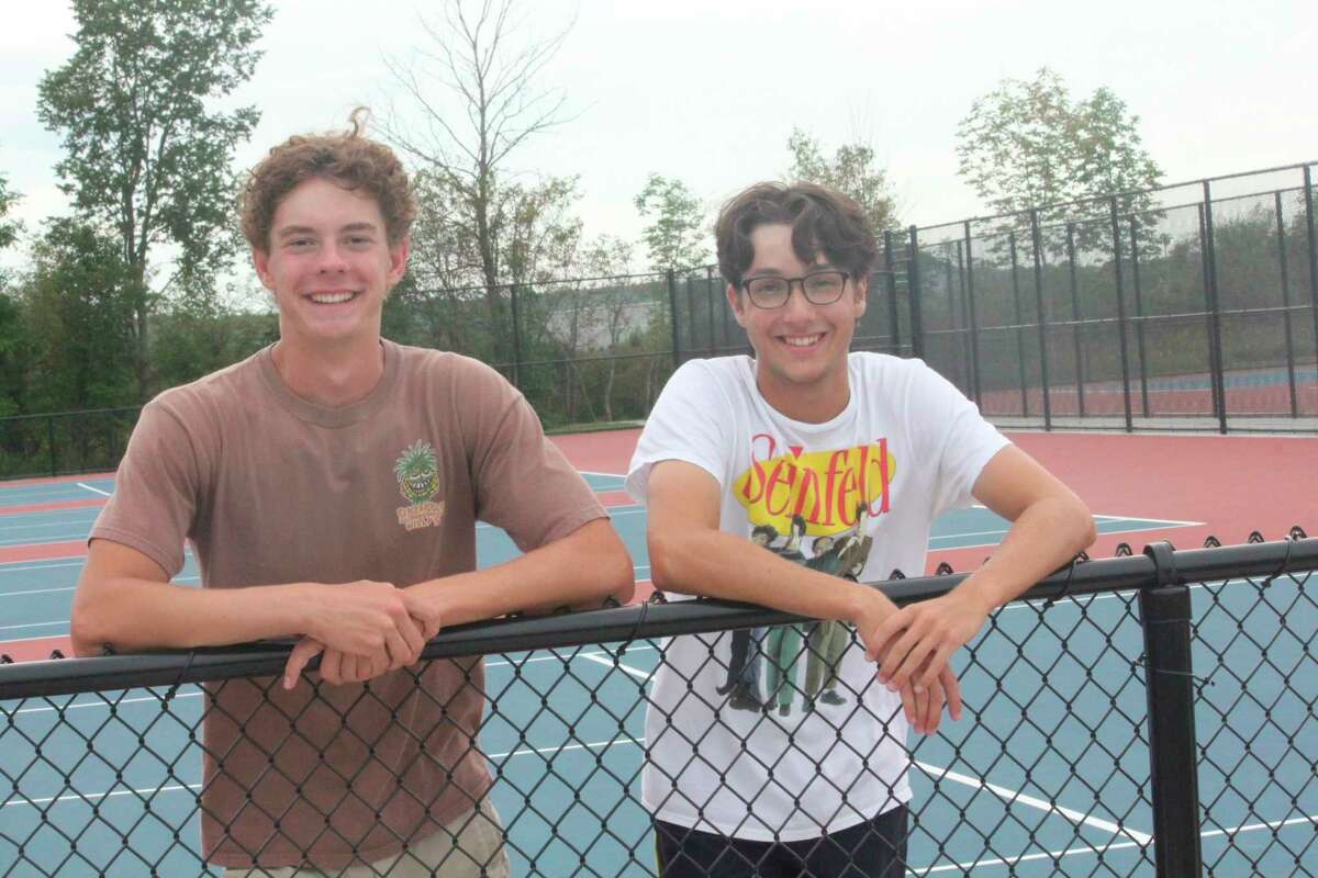 The Big Rapids No. 1 doubles team of Owen Bomay (left) and Jacob McLeod has had a season worth smiling about. (Pioneer photo/John Raffel)