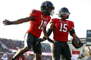 Texas Tech's Kaylon Geiger Sr. (10) and Travis Koontz (15) celebrate after a touchdown during the first half of an NCAA college football game against Florida International, Saturday, Sept. 18, 2021, in Lubbock, Texas. (AP Photo/Brad Tollefson)