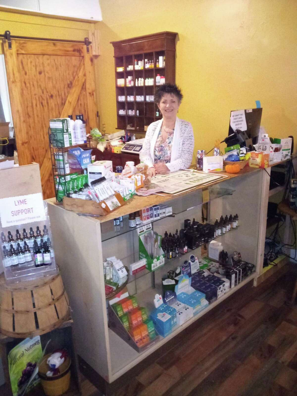 Act Natural, a health and wellness store, recently moved to a new space on Water Street across from its former location. Pictured is owner Pam Pinto.