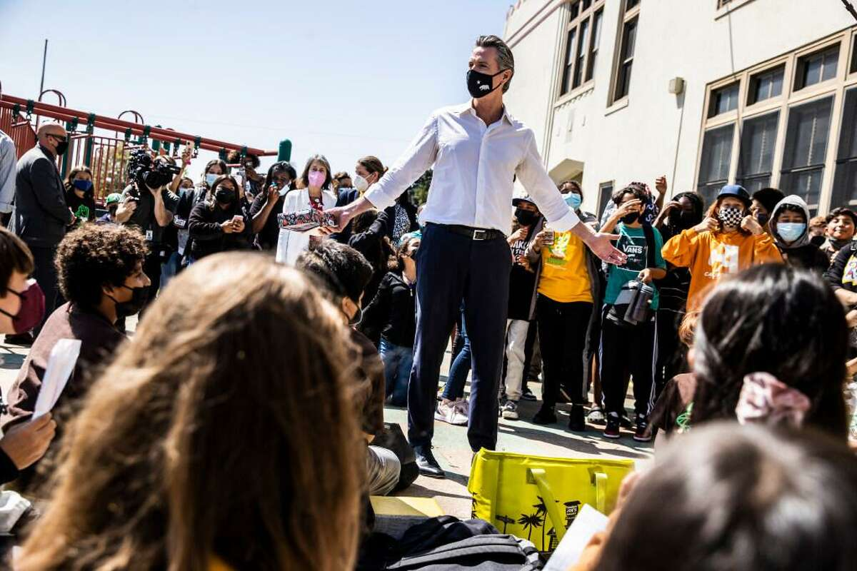 California Governor Gavin Newsom visits Oakland's Melrose Leadership Academy the day after surviving the gubernatorial recall election.