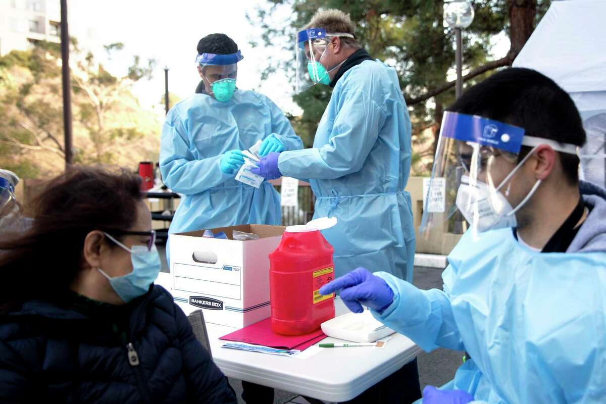 Marin County fire medics administer vaccines at a Greenbrae assisted living facility. The FDA and CDC have approved boosters for certain groups of people.