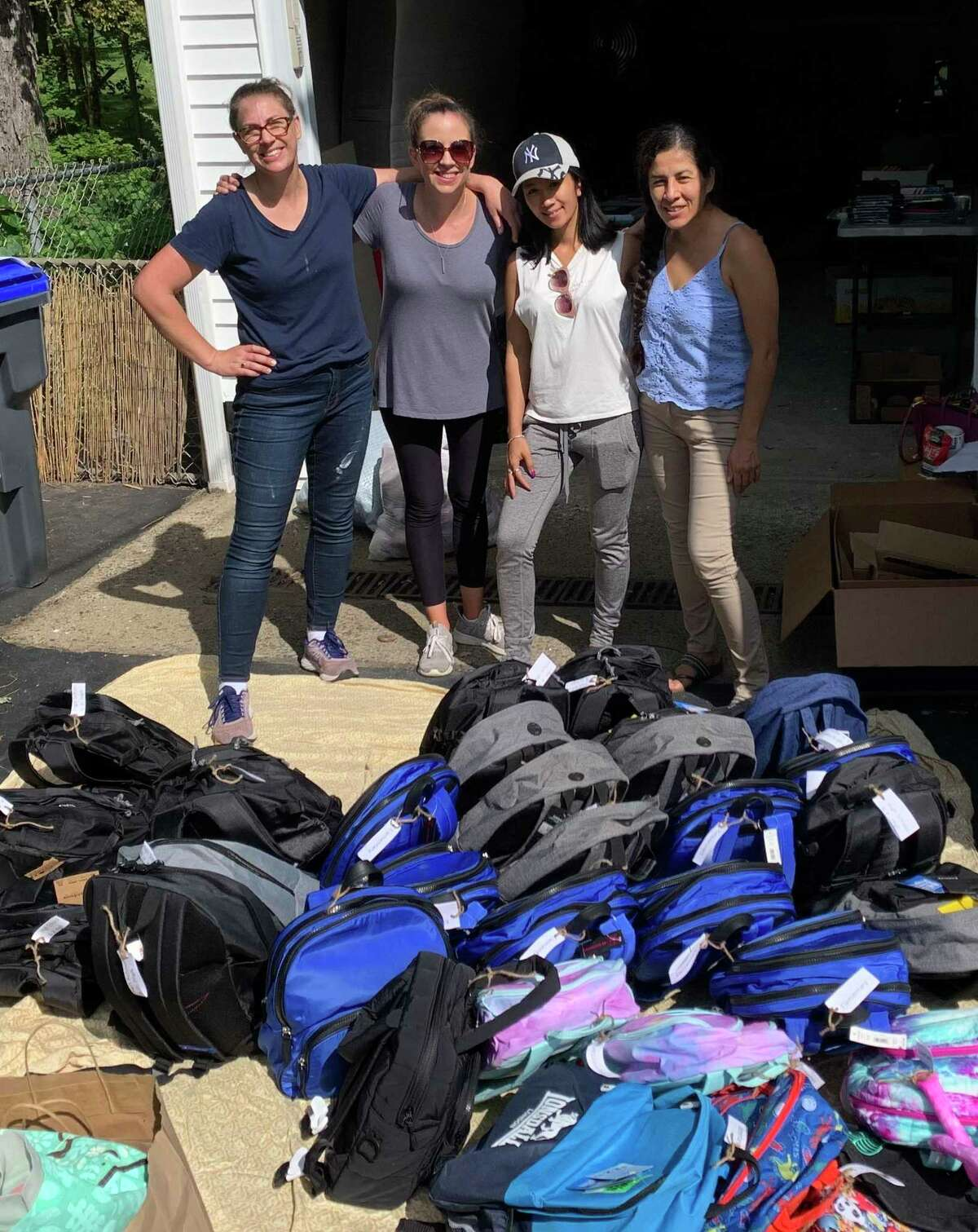 From left - Heidi Leigh Hanson, Heather Miller, Tara Figueroa and Jacqueline Levin are among the local individuals who have taken personal action to help resettle up to 300 Afghan families.