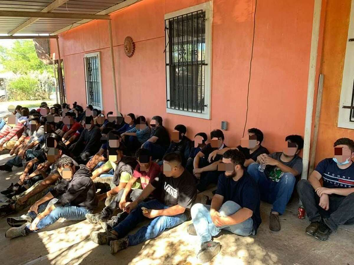 Authorities said these 51 migrants were found inside a stash house in south Laredo. An 18-year-old man was detained in connection with the case.