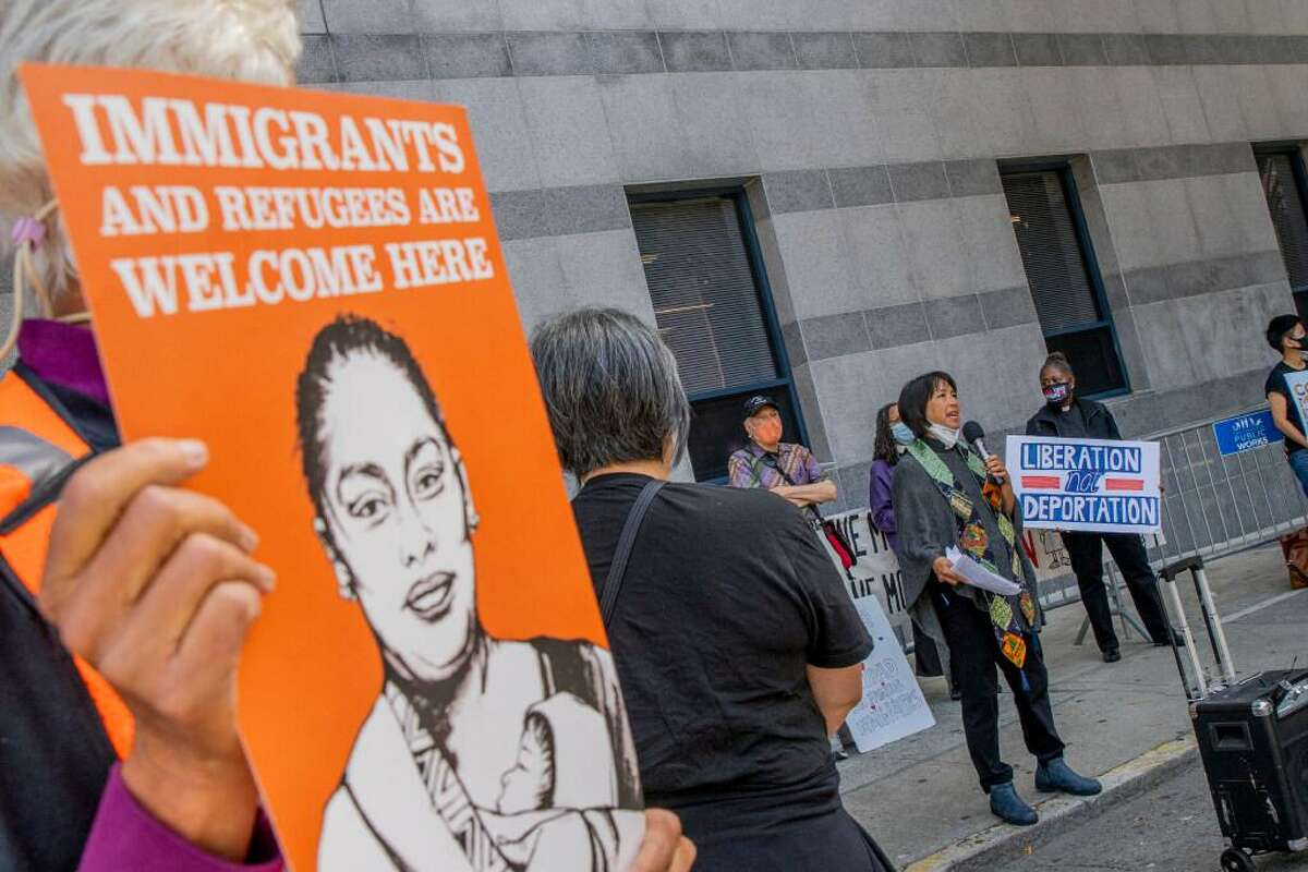 Outside the S.F. offices of U.S. Immigration and Customs Enforcement, people protested Thursday against the recent treatment of Haitian immigrants at the U.S.-Mexico border.