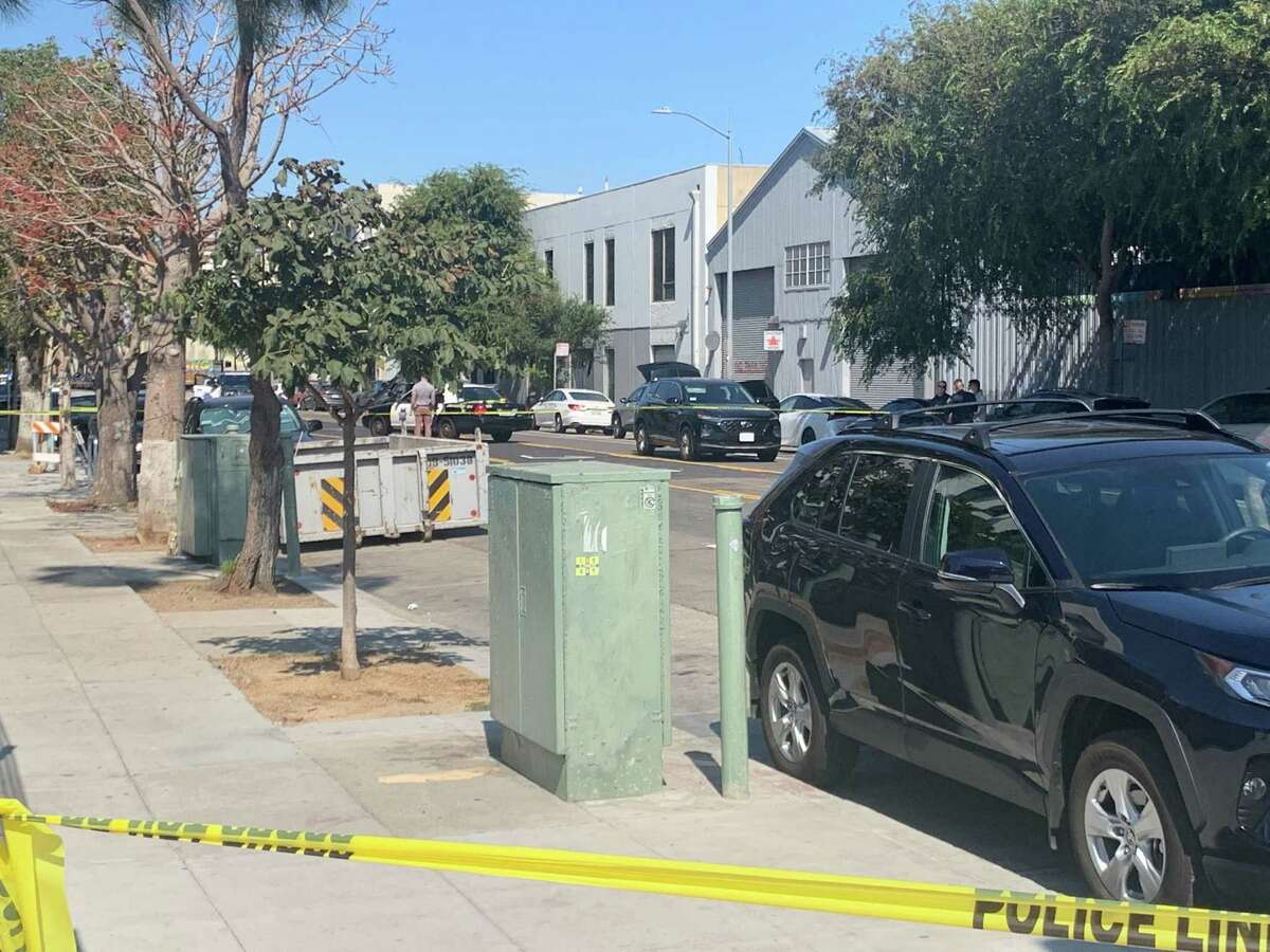 Members of the San Francisco Police Department process the scene of a homicide on Folsom Street between 16th and 17th Street in San Francisco, Calif. Friday, Sept. 24, 2021.