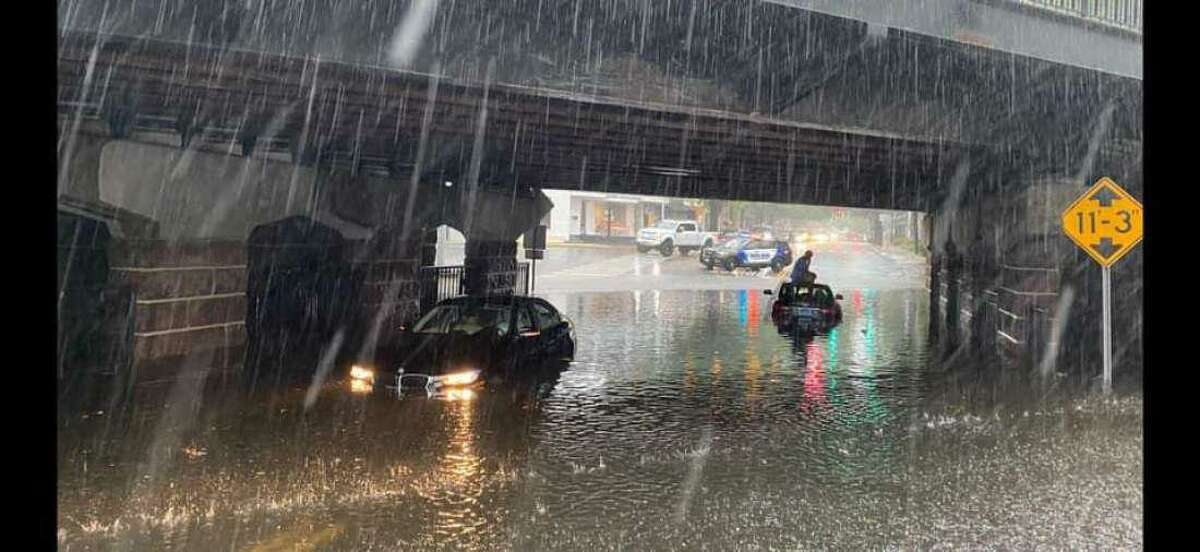 Post Road was closed at Tokeneke Road at the underpass in Darien because of heavy flooding on Friday, July 9, 2021.