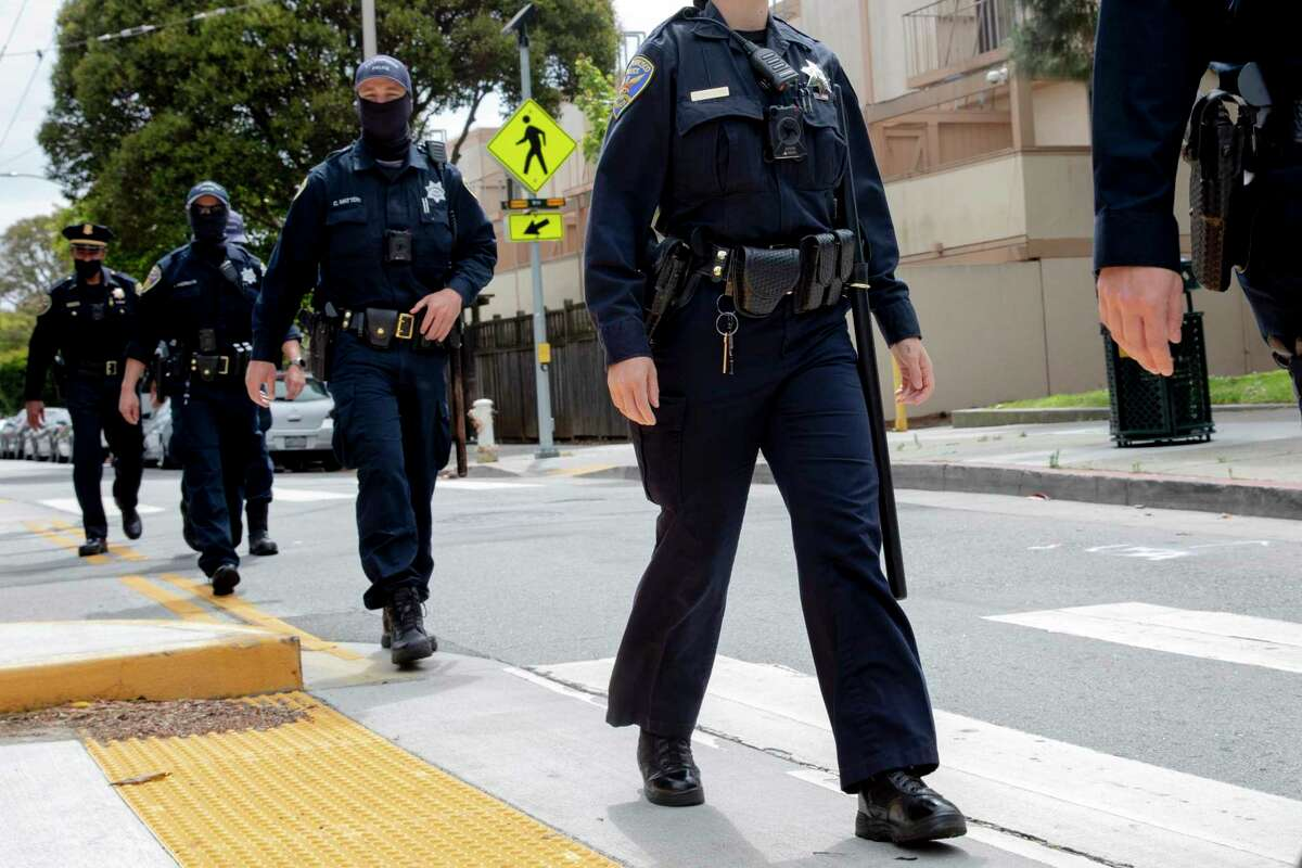 San Francisco Police officers in masks while monitoring a crowd in San Francisco, on June 12, 2020.