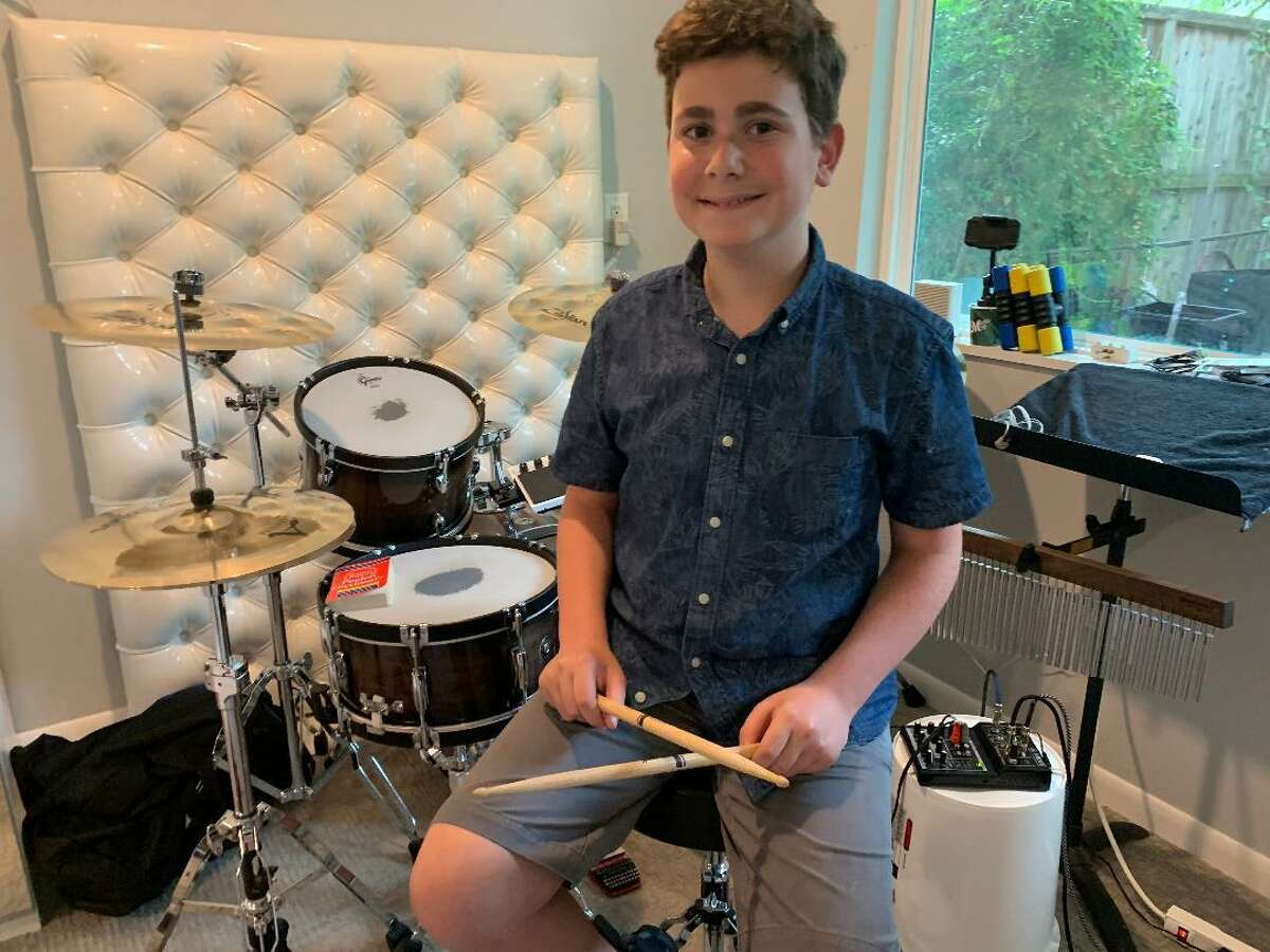 Solomon Levin, 13, is the drummer for the four-member middle school band Mitzvah City Limits who will be performing at Evelyn's Park on October 1 at 5 p.m.