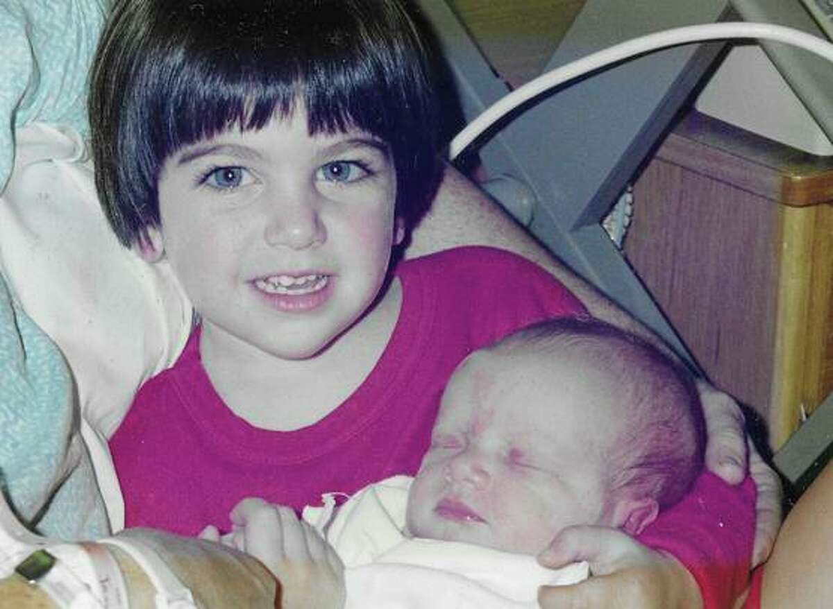 Molly Cahen with her newborn brother, Travis.