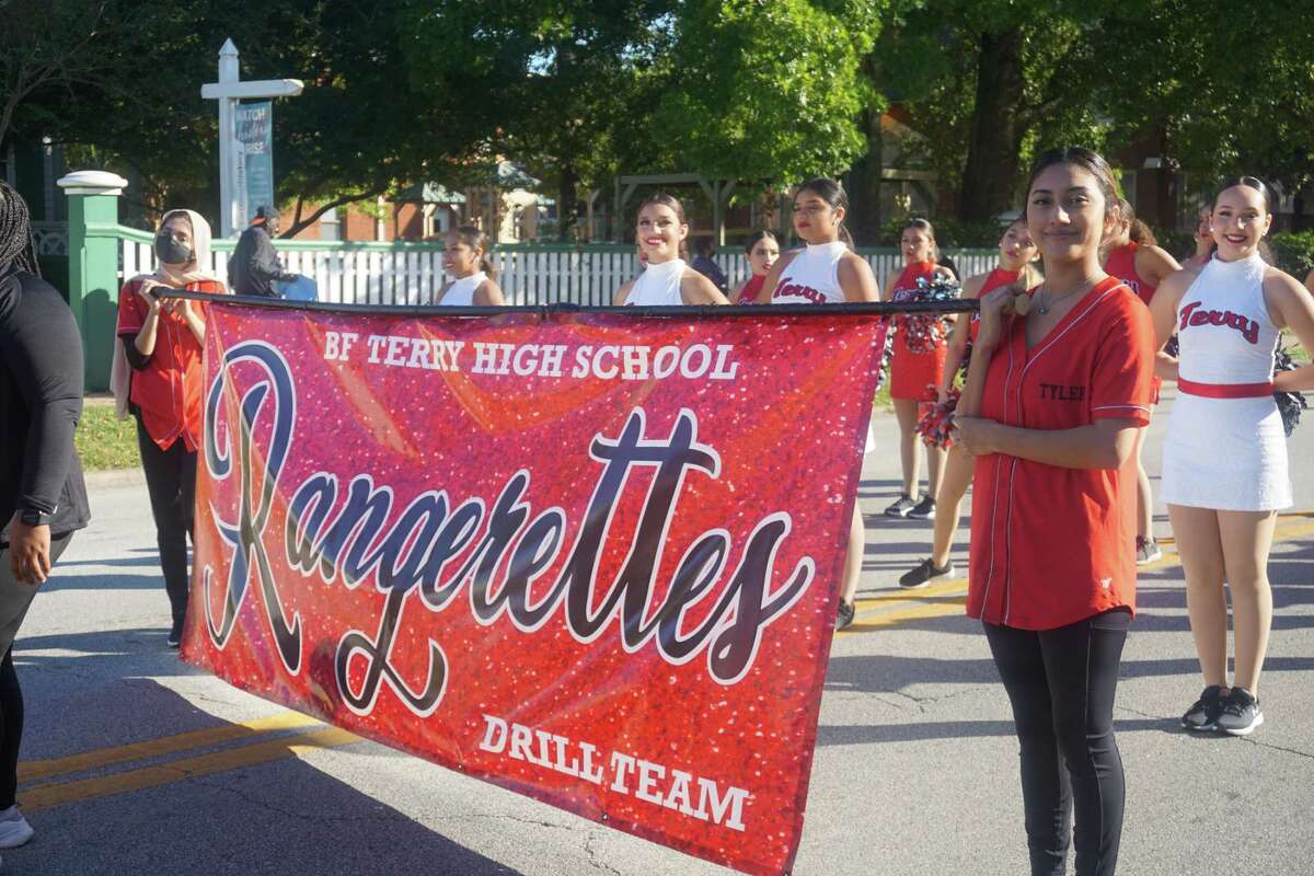"""The Terry High School Rangerettes Drill Team waits to perform in the 85th Annual Fort Bend County Fair """"Tradition Returns"""" Parade on Friday, Sept. 24, in downtown Richmond."""