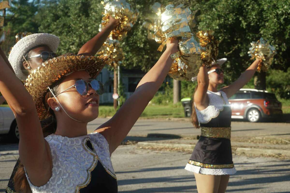 """The Foster High School Flairs Drill Team warms up to march in the 85th Annual Fort Bend County Fair """"Tradition Returns"""" Parade on Friday, Sept. 24, in downtown Richmond."""