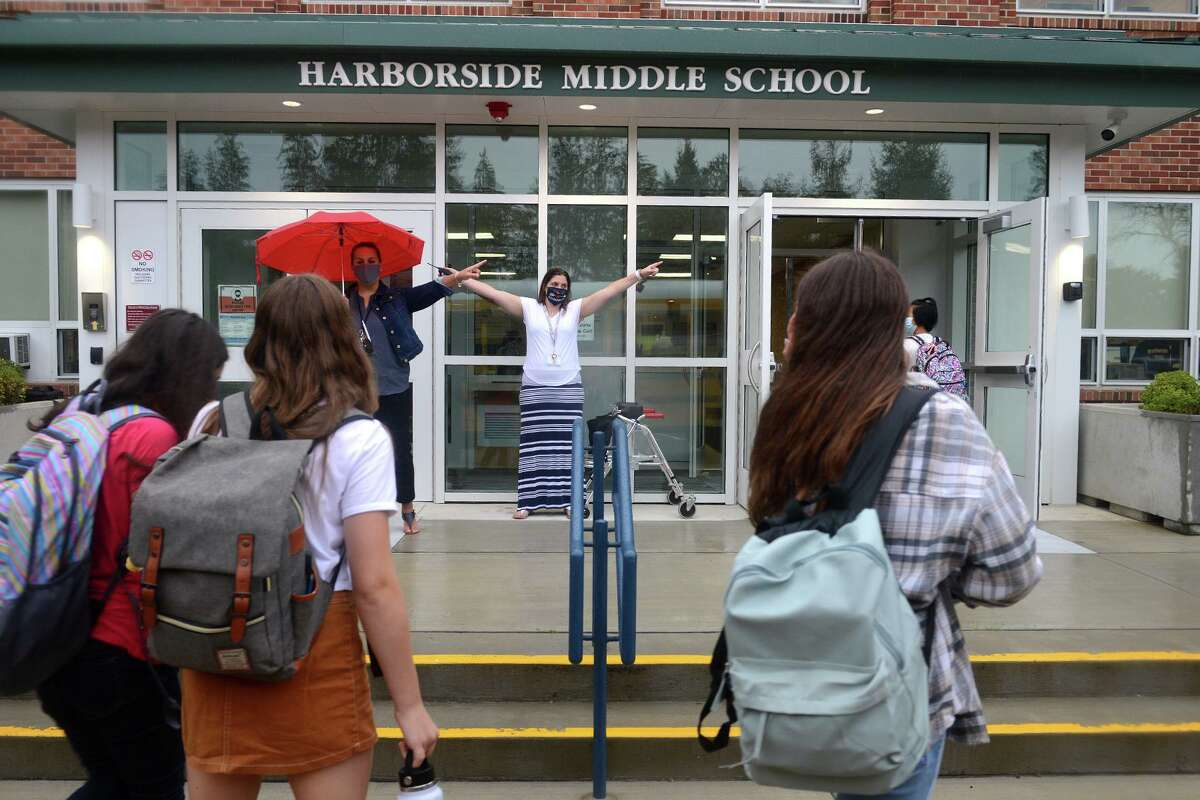 Students arrive for the first day of class at Harborside Middle School, in Milford, Conn. Sept. 1, 2021.