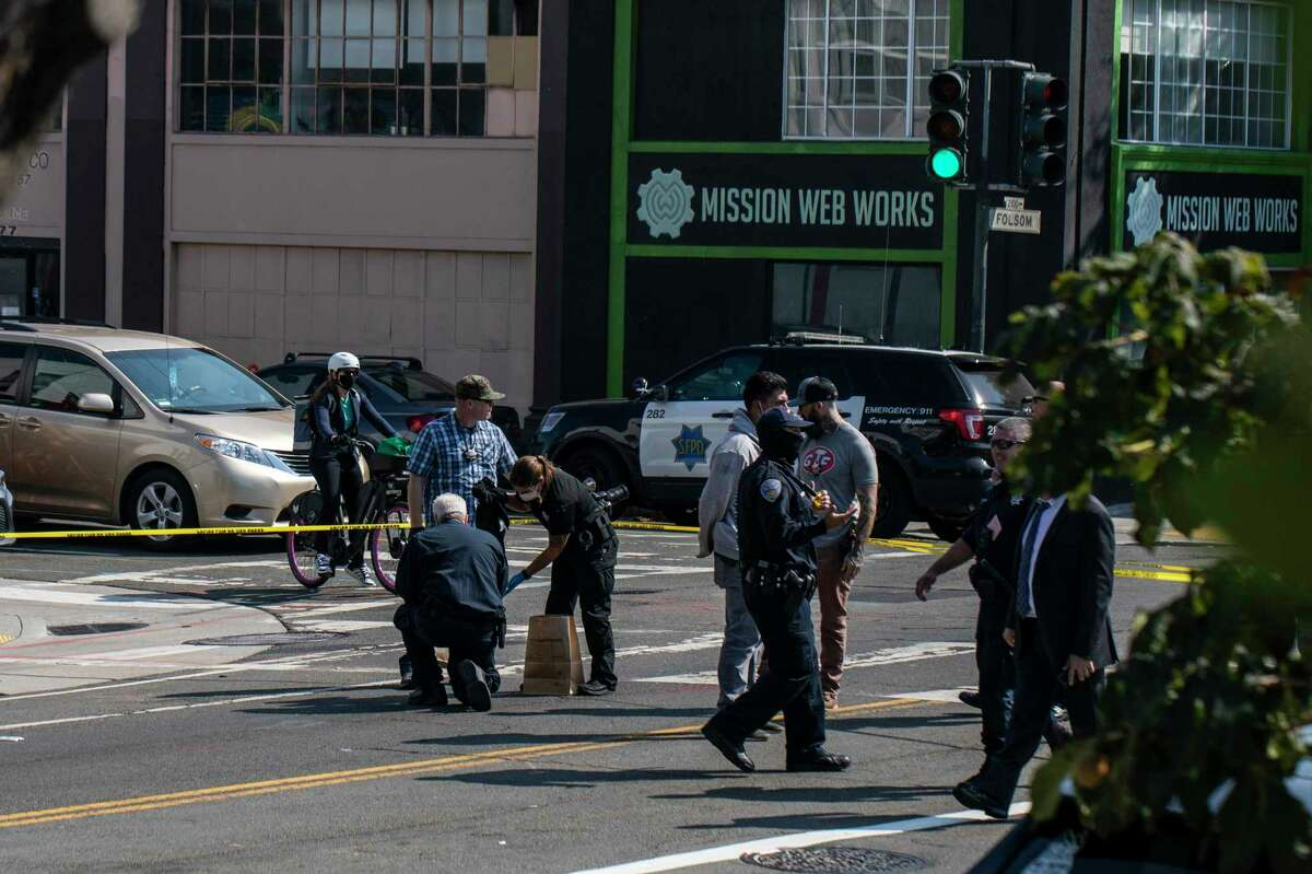 Members of the San Francisco Police Department gather evidence at the scene of a homicide on Folsom Street between 16th and 17th Street in San Francisco, Calif. Friday, Sept. 24, 2021.