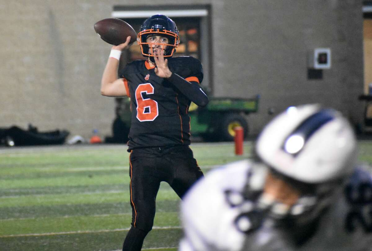 Ridgefield's Justin Keller throws a pass against Xavier during a football game at Maiolo Field, Ridgefield on Friday, Sept. 24, 2021.