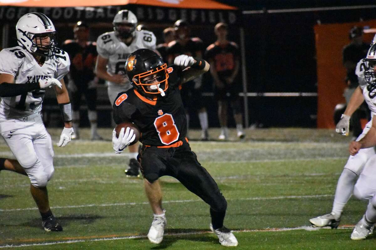 Ridgefield's Jude Vucci looks to find a hole against Xavier during a football game at Maiolo Field, Ridgefield on Friday, Sept. 24, 2021.