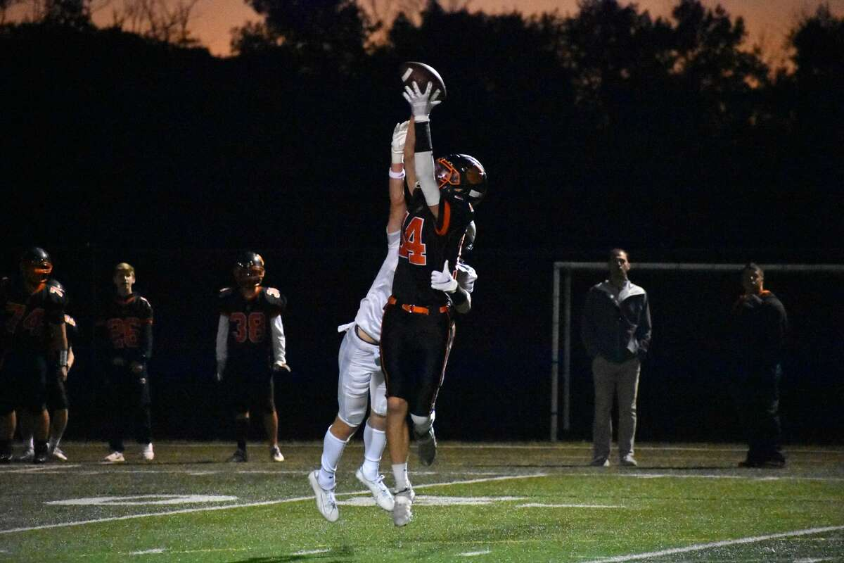 Ridgefield's Kyle Showstead jumps up to make a catch against Xavier during a football game at Maiolo Field, Ridgefield on Friday, Sept. 24, 2021.
